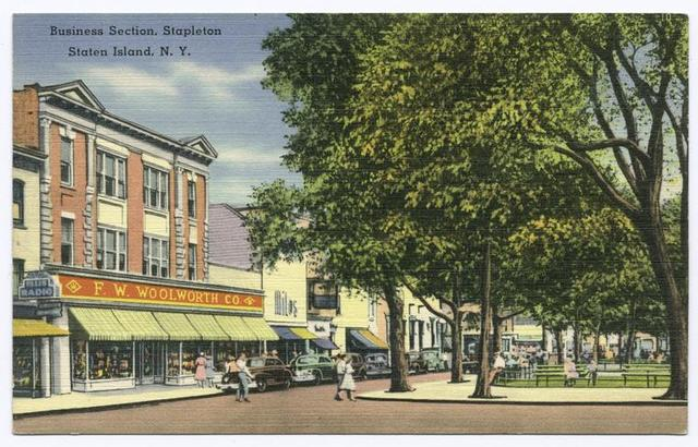 Business Section, Stapleton, Staten Island, N.Y.  [corner of park, with people in street, 40's cars parked in front of shops, F.W. Woolworth, Co., Miles shoes]