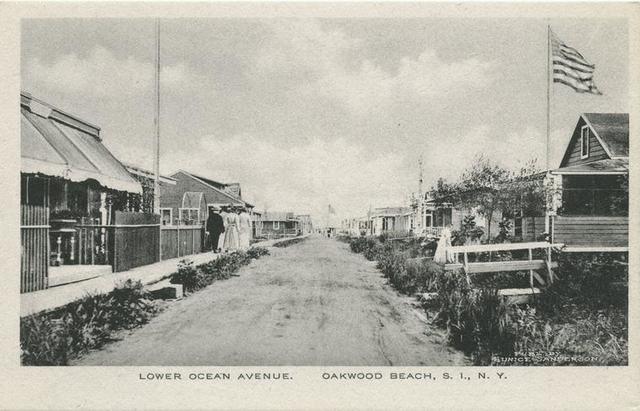 Lower Ocean Avenue, Oakwood Beach, Staten Island, N.Y.  [beach cottages, people walking on raised sidewalk]
