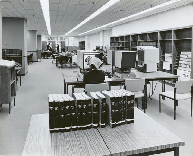 [Mid-Manhattan, User at microfilm viewer.]