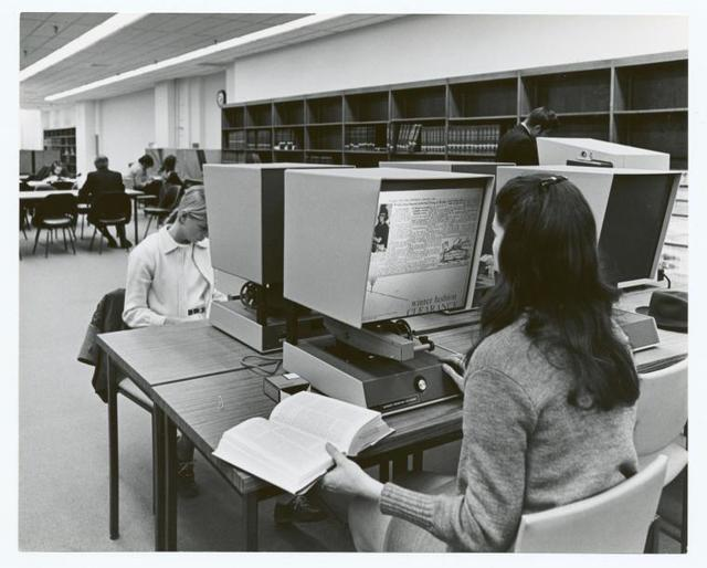 [Mid-Manhattan, Users at the microfilm viewers.]