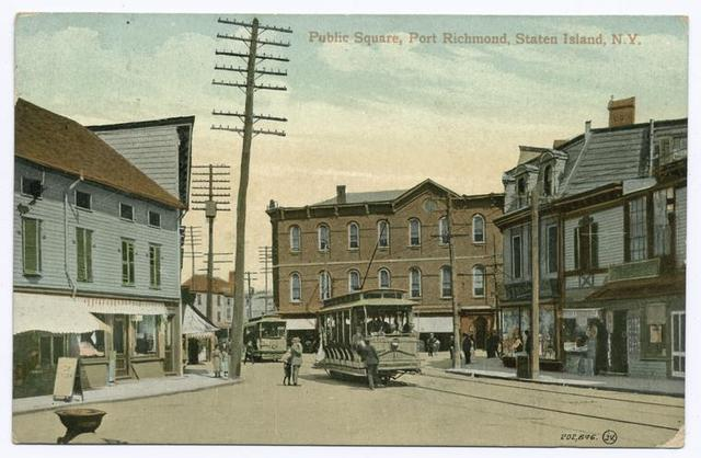 Public Square, Port Richmond, Staten Island, N.Y.  [nice close-up of trolley loading people, and another trolley behind it, shops on street]