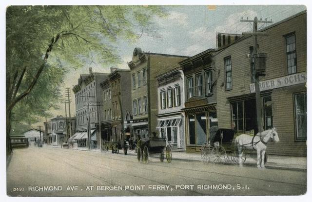 Richmond Ave. at Bergen Point Ferry, Port Richmond, Staten Island [ferry dock in distance, shops and old buildings along street with horse-drawn vehicles]
