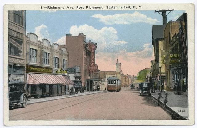Richmond Ave. Port Richmond, Staten Island, N.Y. [trolley, old cars, people walking, shops on both sides of street, shop selling 'Victrolas', Palace theater]