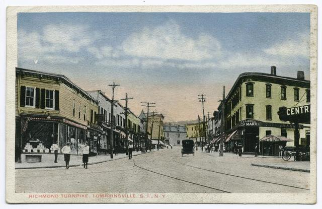 Richmond Turnpike, Tompkinsville, Staten Island,  N.Y.  [great view of street with people, markets, old car, trolley tracks, shops with awnings, Plaza Market on Corner]