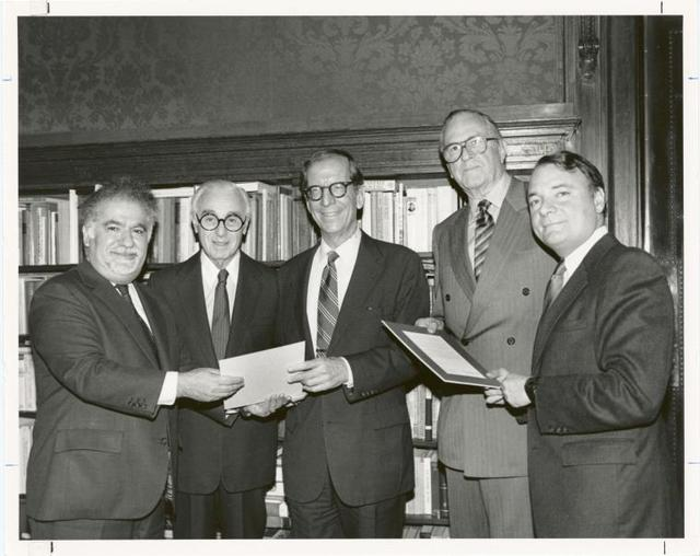State senator Roy M. Goodman (center) and Assemblyman Mark Alan Siegel (right) receive resolutions of appreciation for their leadership efforts in securing funding for a new Library for the Blind and Physically Handicapped.  Presenting the resolutions at the annual meeting of the Board of Trustees are Vartan Gregorian, Senator Abraham A. Ribicoff, and Chairman Andrew Heiskell.