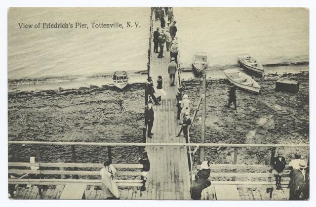View of  Friedrich's Pier, Tottenville, N.Y. [people on wooden boardwalk and pier.]