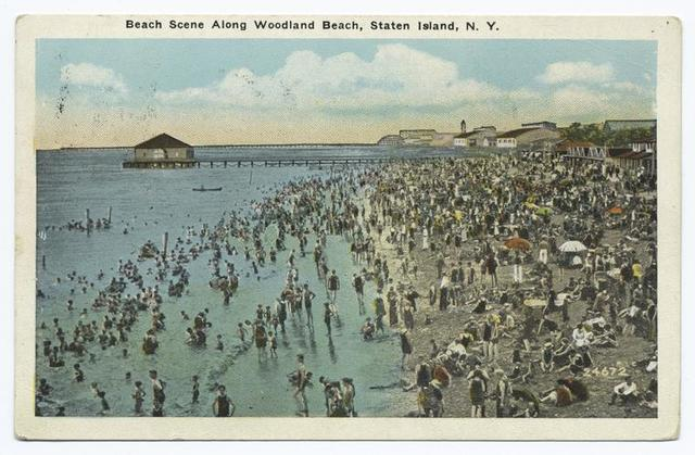 Beach Scene Along Woodland Beach, Staten Island, N.Y.  [pier, pavilion, people on beach and in water].