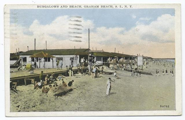 Bungalows and Beach, Graham Beach, Staten Island, N.Y.  [buildings, wood walkway and people on sand.]