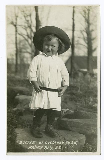 'Buster' of Overlook Park, Prince(sic) Bay, S.I. (toddler in sun hat and dress)