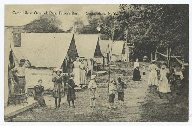 Camp Life at Overlook Park, Prince's(sic) Bay. Staten Island, N.Y. [people in old- fashioned garb standing and walking in front of tents.]
