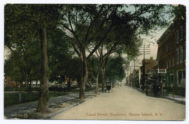 Canal Street, Stapleton, Staten Island  [buildings with shops, horse-drawn vehicles at curb and on street, edge of Washington Park and village hall]