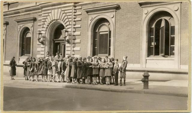 [Children lined up outside Mott Haven.]