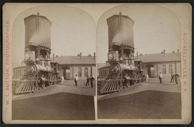 [Erie Railroad yard showing locomotive and watertower.]