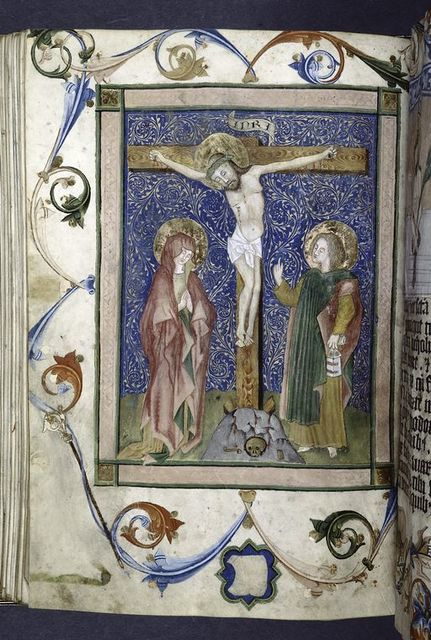 Full page miniature of Crucifixion; John holds what appears to be a book in a chemise binding; the blank shield in the lower margin appears never to have been filled in (one might have expected to find a small cross in this location).