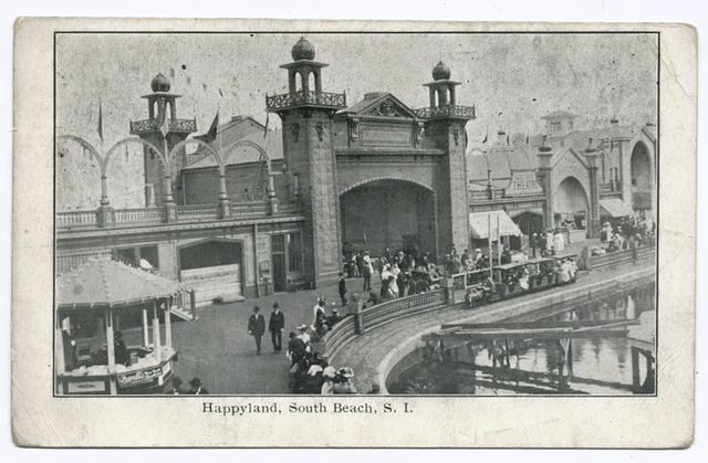 Happyland, South Beach, S. I. [turreted entrance building next to electric theatre,  with people at boardwalk railing looking out over water]