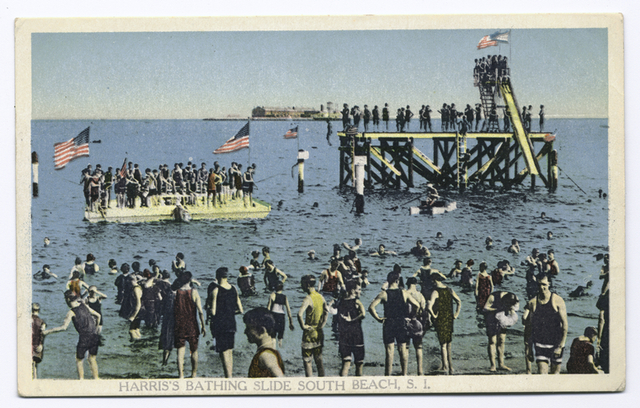 Harris's Bathing Slide South Beach, Staten Island. [people wading at shoreline, people on float and on giant water slide, Hoffman Island military base in background]