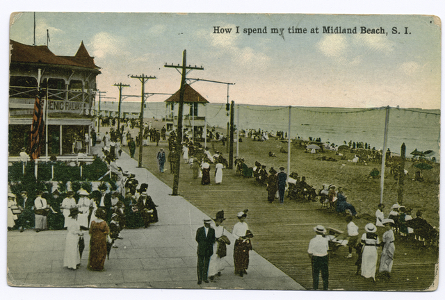 How I Spend my time at Midland Beach, Staten Island. [people on boardwalk, Scenic Railway building.]
