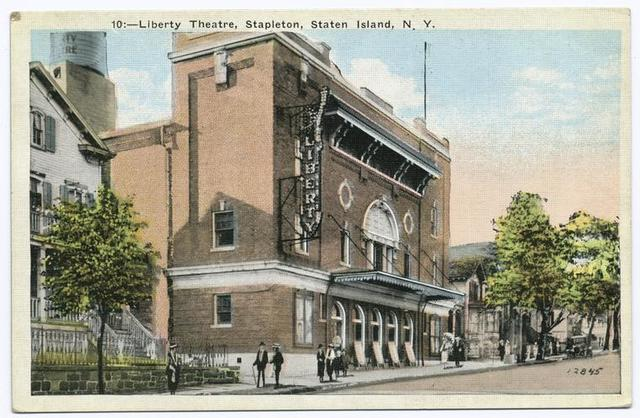 Liberty Theatre, Stapleton, Staten Island, N.Y.  [full ext. view with people strolling out front, billboards on sidewalk in front of building]