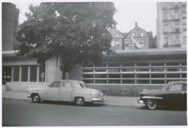 [Mosholu, Exterior, two cars in front.]