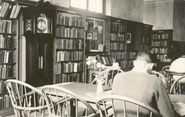[New Dorp, Seated reader and grandfather clock.]