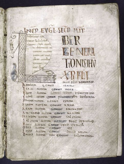 Opening of Gospel of Matthew.  Section of parchment around the large initial has been cut out -- text of next folio is visible through the hole. Rustic capitals.