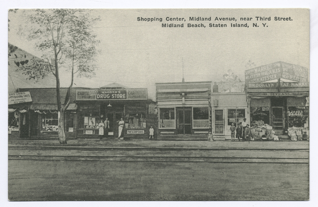 Shopping Center, Midland Avenue, near Third Street, Midland Beach, Staten Island [pub. Wagner Pharmacy]  [Stores: Wagners Pharmacy, donut store, food market and dry goods store, people on street, trolley tracks]