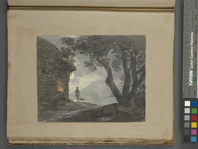Silhouette of man and dog outside cottage