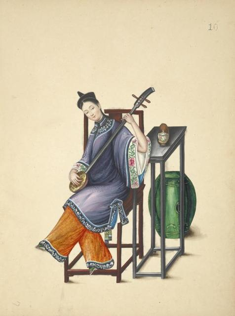 Woman seated at table, playing a sanxian.
