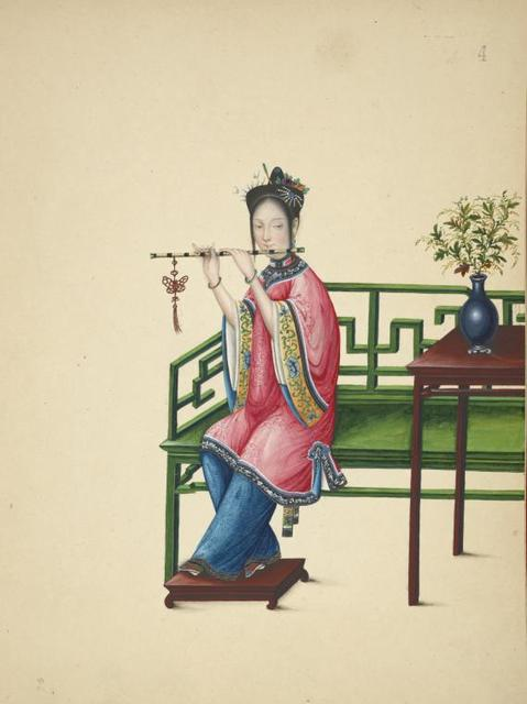 Woman seated on a long green bench, playing a dizi.