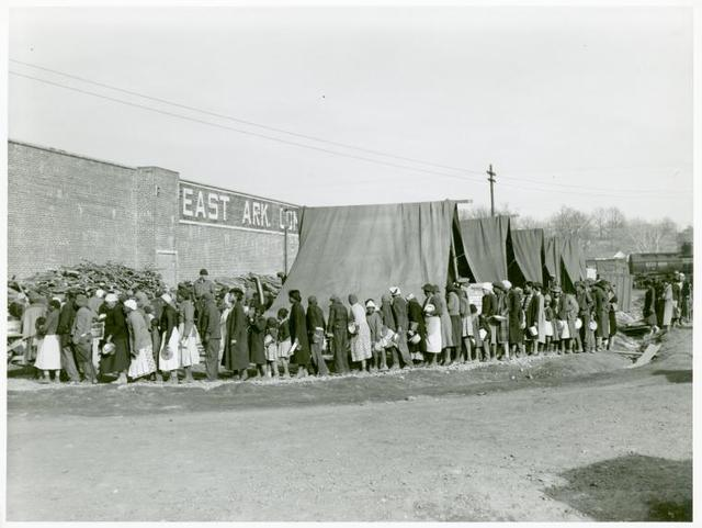 Negro flood refugees lined up and waiting for food in Forrest City, Arkansas camp; Feb. 1937.