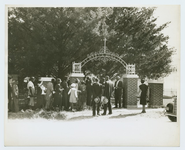 On All Saints' Day at New Roads, La. Negroes assembled in the church for preliminary ceremnoies and then marched en masse to the cemetry for ceremonies there; The part of the group is shown entering the cemetry.