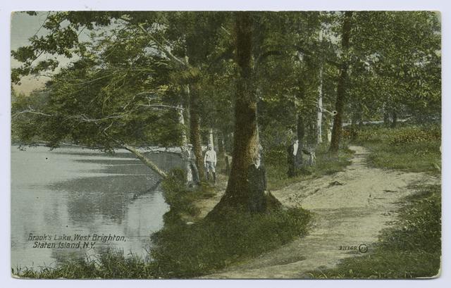 Brook's Lake, West Brighton, Staten Island, N.Y. [people standing against trees on shoreline]
