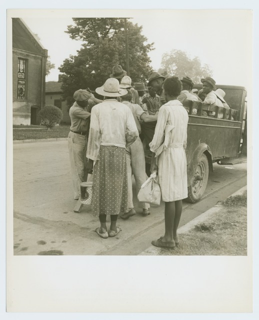 Cotton hoers leaving Greenville at 5 a.m. for a day's work on the plantations; Wages one dollar a day, one dollar and twenty-five cents on a few plantations; Hoers carry their lunches; They return about 8 p.m. Mississippi.