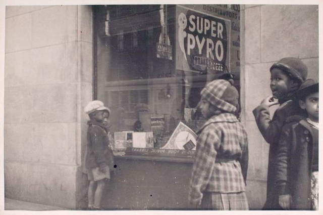 Exterior, children looking in at window display