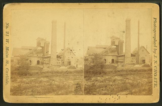 [Industrial building with inclined plane and large smokestack.]