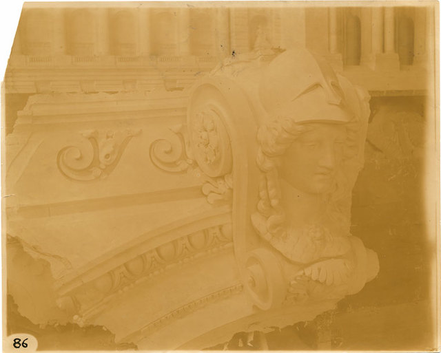 [Plaster model of architectural decoration, including the head of Athena adorning a volute.]