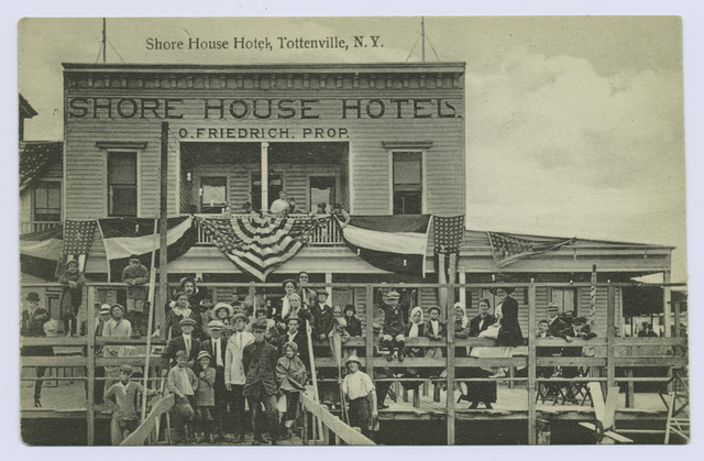 Shore House Hotel,  Tottenville, N.Y. [on front of building- 'Shore House Hotel, O. Friedrich, Prop., many people in old garb posed on deck and dock, hotel draped in flag bunting]