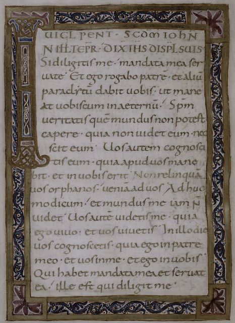 Text for Pentecost in gold, in gold and paint frames.  Large decorated initial.