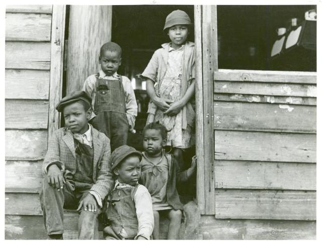"Family of small landowner who moved out of the Santee-Cooper Basin, at their ""new home"" near Bonneau, South Carolina."