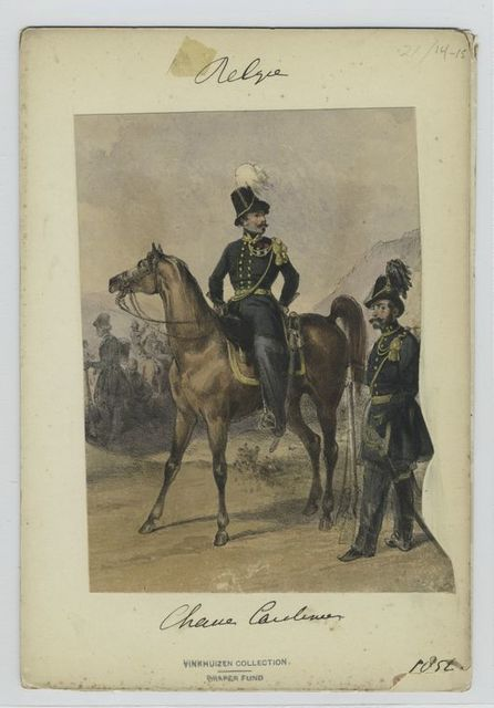 Mounted officer with another officer standing beside the horse.
