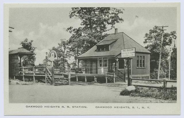 Oakwood Heights R.R. Station, Oakwood Heights, Staten Island, N.Y. [station with platform and people waiting for train, sign reading This Crossing Protected by Flagman between 7 a.m. and 7 p.m.]