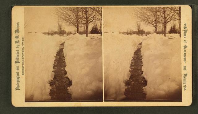 [Pathway made through deep snow.]