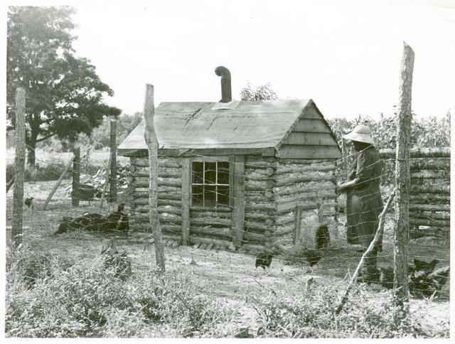 Pauline Clyburn, rehabilitation client at Manning, Clarendon County, South Carolina, with chicken house she made herself; The window she took from her own bedroom.