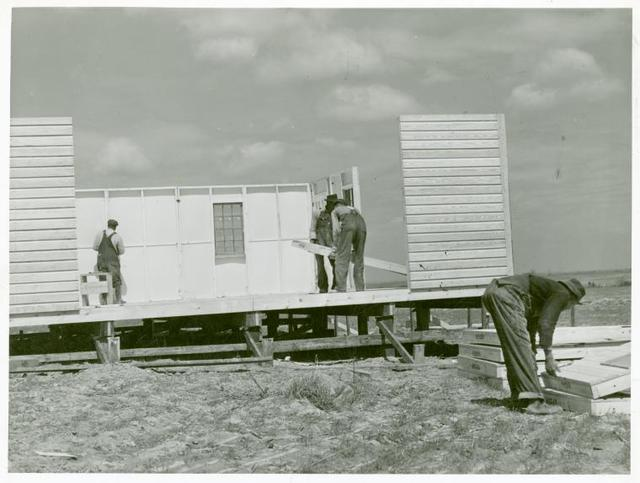 Putting up the walls on a prefabricated house at the FSA [Farm Security Administration] project in Pacolet, South Carolina.