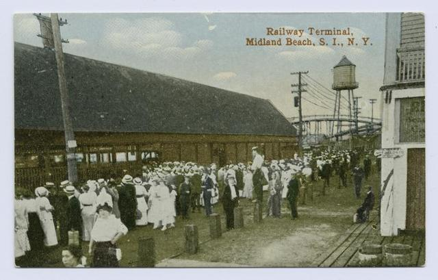 Railway Terminal, Midland Beach, Staten Island, N.Y.  [people waiting on station platform, ladies in old-fashioned dresses and men in straw hats, wooden water tower in background]