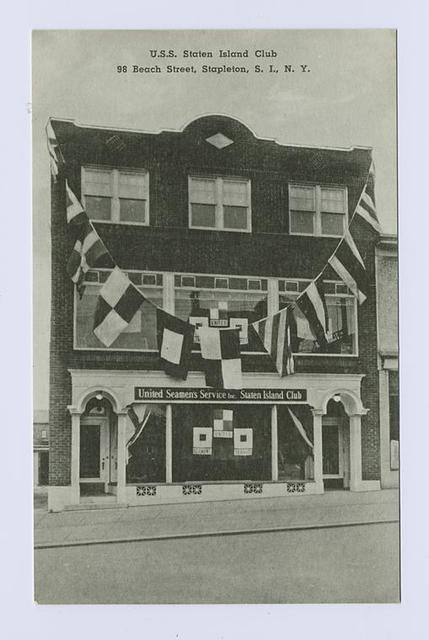 U.S.S. Staten Island Club, 98 Beach Street, Stapleton, S.I., N.Y. [building ext. draped with semaphore flags and sign 'United Seamen's Service, Inc., Staten Island Club']
