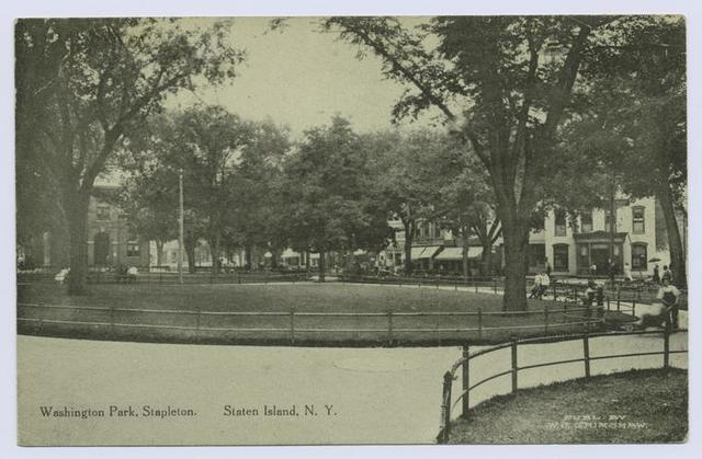 Washington Park, Stapleton, Staten Island, N.Y.  [view from center of park includes shops and stores on street]
