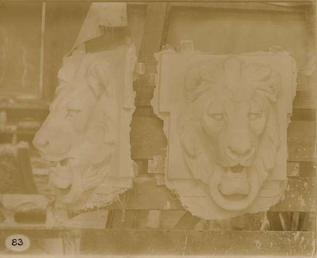 Plaster models of a lion's head.